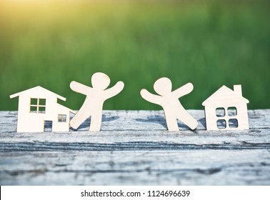little wooden men in houses. Symbol of neighborhood, friendship, teamwork and sweet home concept