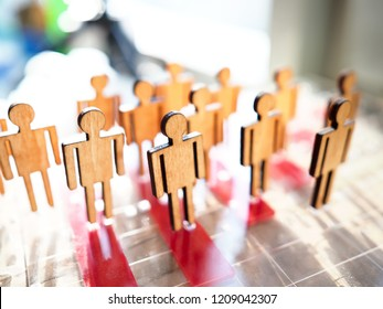 Little wooden toy people figures stand in row closeup. Teambuild hr poll net elector politics crowdfunding relationship labour talent public opinion concept