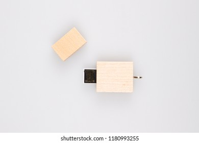 little wooden USB Flash Memory Drives on white background