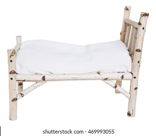 Little wooden vintage bed for baby from a birch isolated on a white background. Props for newborn photoshoot