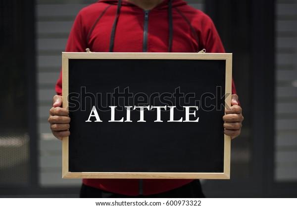 a little written on blackboard with someone is holding it