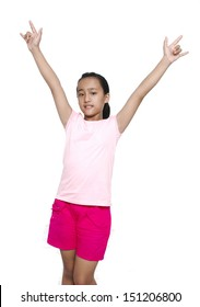 little years girl raises her hands in a victory sign