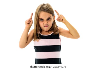 Little young girl is angry, mad, disobedient with bad behaviour. Children making the act of insubordination and disobedience, yelling, flipping off, showing the middle finger. Act of giving the finger