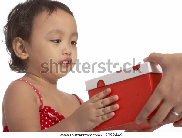 little young girl holding a red gift box