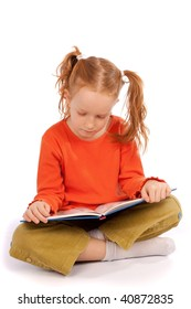 Little young girl reading a book, isolated on white