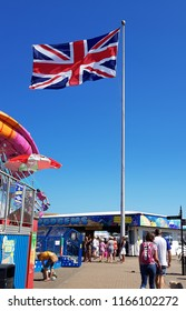 Littlehampton, Brighton UK - 07 15 2018 : The Union Jack flying at the sea front
