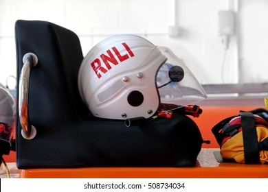 Littlehampton, UK - October 25 2016: RNLI (Royal National Lifeboat Institution) helmet ready on a lifeboat at Littlehampton, Sussex