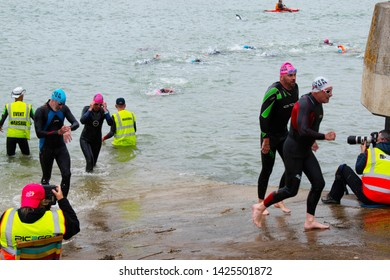 Littlehampton, West Sussex, England, June 15, 2019, River Arun swim over the classic Ironman distance of 3.8km from Ford to Littlehampton. Competitors at the finish.