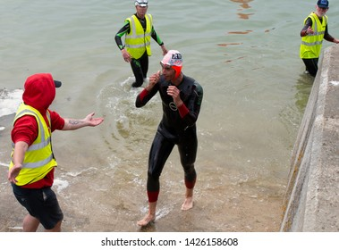 Littlehampton, West Sussex, England, June 15, 2019, River Arun swim over the classic Ironman distance of 3.8km from Ford to Littlehampton. Finish Line Second place Andrew Gowland.