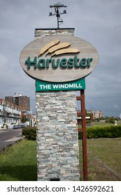 Littlehampton, West Sussex, England, June 14, 2019 Harvester Restaurant sign near Littlehampton seafront.