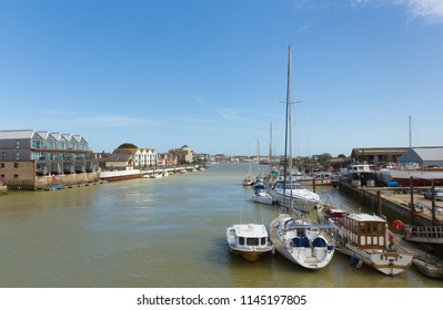Littlehampton West Sussex River Arun with boats and view towards the sea