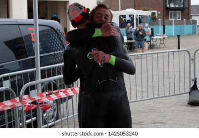 Littlehampton, West Sussex, UK, June 15 2019, River Arun swim over the classic Ironman distance of 3.8km from Ford to Littlehampton. First and Second place embrace.