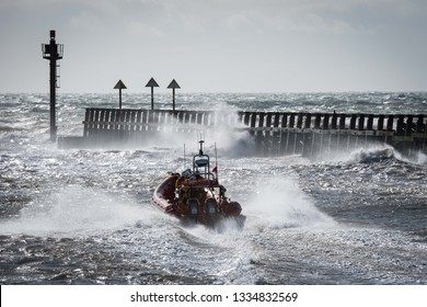 "LITTLEHAMPTON, West Sussex, UK - MARCH 10, 2019:  Littlehampton's Atlantic 85 RNLI lifeboat ""Renée Sherman"" heading into blustery conditions after leaving harbour on a training exercise."