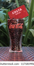 Littlehampton, West Sussex, UK September 2018. Vintage Coca Cola Glass with Coffee Beans and a Costa Coffee Club Card
