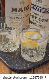 Littlehampton,West Sussex / United Kingdom - July 20th 2018 : A glass of Gin and Tonic and Scotch Whisky with Vintage bottles of Haig Scotch Whisky and Booths London Gin, Dated 1961.
