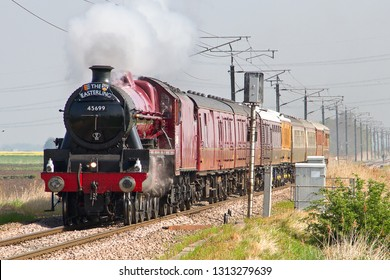 LITTLEPORT, CAMBRIDGESHIRE, UK - MAY 19, 2013: LMS Jubilee Class 4-6-0 No. 45699 'Galatea' heads south towards Littleport, working the first leg of a Birthday Special Charter for RTC's Nigel Dobbing.