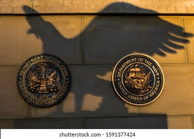 Littleton, Colorado, USA, October 6, 2019: Shadow of American Eagle on plaques of Army and Navy at Veteran Memorial