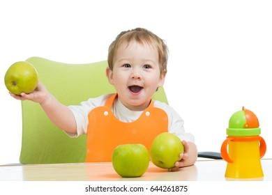 littlle boy with green apples, isolated on white