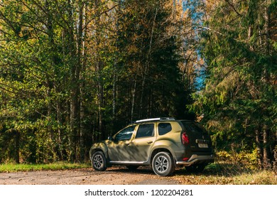 Litvichi, Belarus - October 9, 2018: Car Renault Duster SUV in autumn forest landscape. Duster produced jointly by French manufacturer Renault and its Romanian subsidiary Dacia.