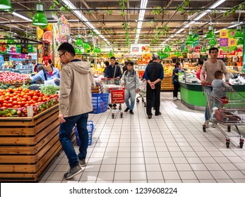 Liuzhou, Guangxi/China-Nov 7th 2018: many Chinese people shopping for groceries in RT-Mart supermarket.