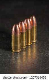 Live 9mm ammunition lined up.