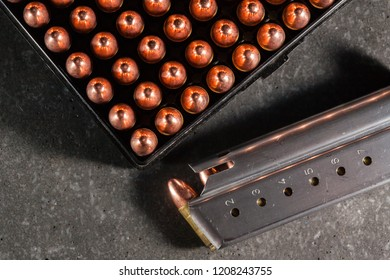 Live 9mm ammunition with loaded magazine.