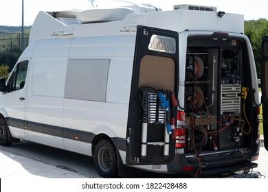 The live broadcast car used in television is waiting for a TV show shooting outside