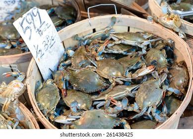 Live crabs sold on a street market, at Chinatown, Manhattan, New York, USA