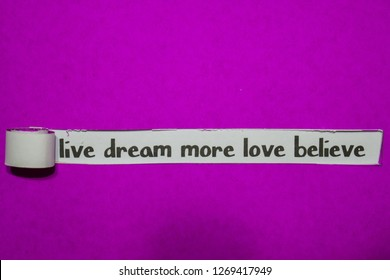 Live Dream More Love Believe, Inspiration, Motivation and business concept on purple torn paper