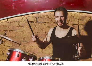 Live to drum, drum to live. Handsome man play percussion instrument. Man drummer playing musical instrument. Rock concert or rehearsal in music club. Enjoying instrumental music. Rock star or rocker.