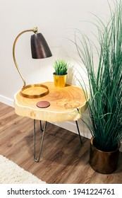 Live edge wood table on hairpin legs.