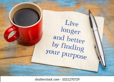 Live longer and better by finding your purpose - handwriting on a napkin with a cup of coffee