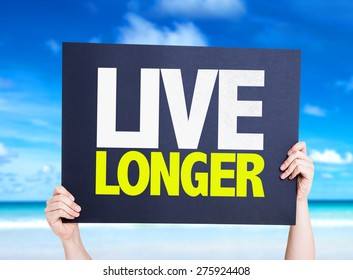 Live Longer card with beach background