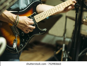 live man playing electric guitar in a live band