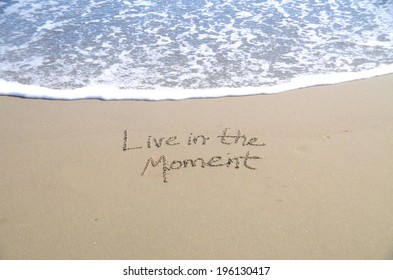 Live in the moment, a message written in the sand.