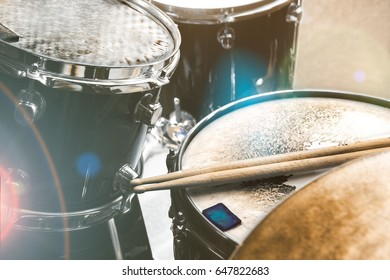 Live music background in vintage style.Drum kit on stage and lights