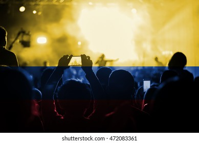 live music concert with blending Colombia flag on fans