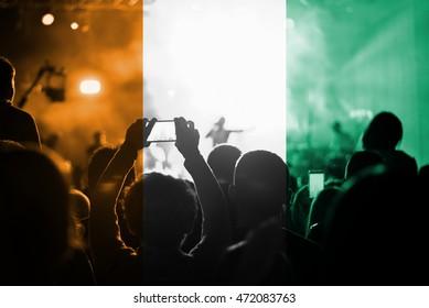 live music concert with blending Cote d'Ivoire  flag on fans