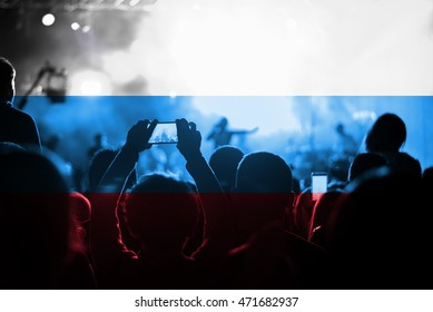 live music concert with blending Russian Federation flag on fans