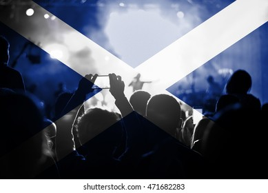 live music concert with blending Scotland flag on fans