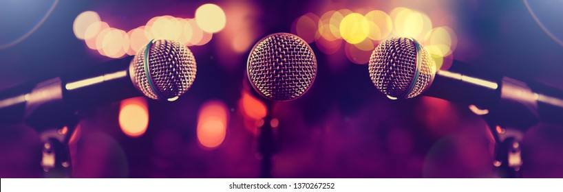 Live music and conference background.Karaoke and entertainment concept.Microphone and stage lights.Concert and music concept