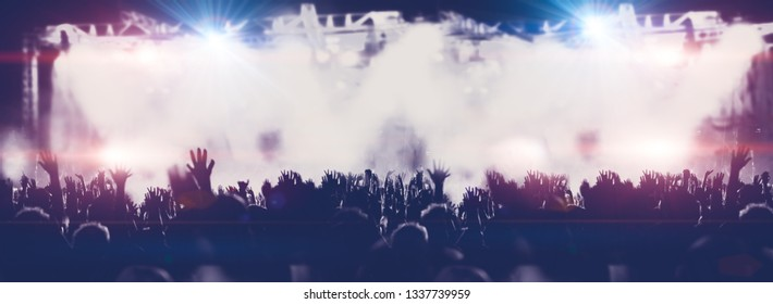 Live music and night entertainment.Public and concert background. Stage lights and people clapping