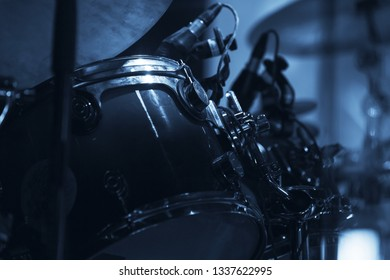 Live music photo with drum set. Blue tonal filter effect
