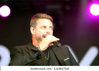 LIVE MUSIC - Pop Star and actor Keith Duffy on stage with Boyzone in concert at York Racecourse : York Racecourse, The Knavesmire, York, UK : 28 July 2018 : Pic Mick Atkins