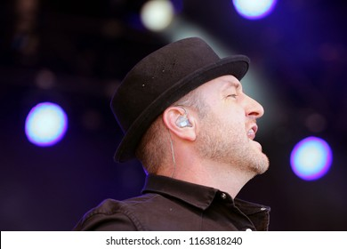 LIVE MUSIC - Pop Star Mikey Graham on stage with Boyzone in concert at York Racecourse :  York Racecourse, The Knavesmire, York, UK : 28 July 2018 : Pic Mick Atkins