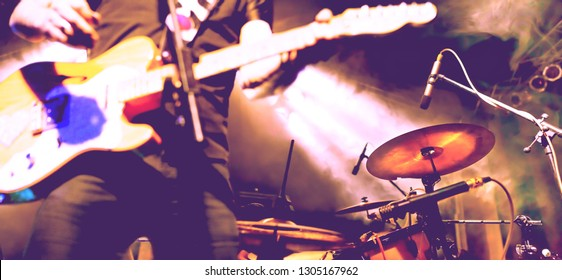 Live music and rock band on stage.Abstract musical background. Playing guitar and music concert concept.