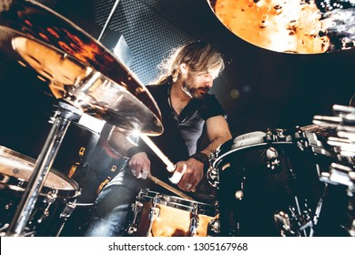 Live music and rock band on stage.Music background. Playing drum and music concert concept.