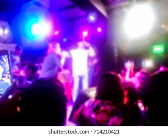The live music scene of the pop band is very popular with the audience. Concert pictures at night time. Abstract photo blur