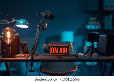 Live online radio studio desk with on air sign, entertainment and communication concept