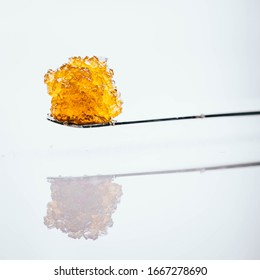 Live Resin Dab Sauce Cannabis Oil Macro with Jar Isolated Legal California Extracts from Weed Dispensary